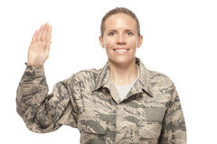 Female airman with hand raised for oath Royalty Free Stock Photo