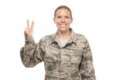 Female airman with peace sign. Portrait of cheerful female airman gesturing peace sign Stock Images