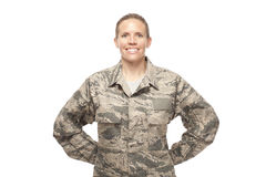 Female airman posing against white background Royalty Free Stock Images