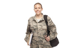 Female airman with shoulder bag and books Royalty Free Stock Photography