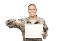 Female airman showing placard Royalty Free Stock Photos