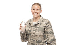 Female airman with water bottle Royalty Free Stock Photo