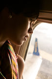 Female airplane passanger enjoying the view Royalty Free Stock Images