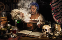 Female alchemist Stock Images