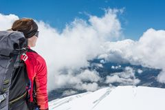 Female alpinist enjoying the view. Royalty Free Stock Images
