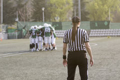 Female American football referee standing on the field and blurr Royalty Free Stock Images