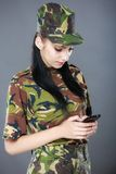 Female American soldier reading a text message Royalty Free Stock Image