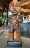 Female ancestor called Parekura of the Waitakere tribe. Auckland, New Zealand - March 2, 2017: Closeup of female Ancestor wood sculpture inside Arataki Maori stock photo