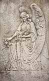 Female angel carved in stone Royalty Free Stock Image
