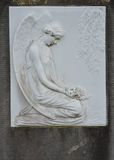 Female angel carved in stone Stock Images