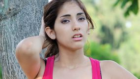 Female And Anxiety. A pretty young Peruvian adult female royalty free stock photo