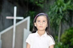 Female And Apathy At Church. An attractive and asian person stock images