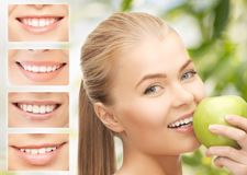 Female with apple and smiles. Healthcare, medical and stomatology concept - female with apple and smiles Royalty Free Stock Images