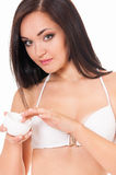 Female applying cosmetic cream for skin care Stock Images