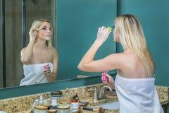 Female Applying Makeup Stock Photo
