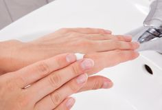 Female Applying Moisturizer To Hand Royalty Free Stock Image