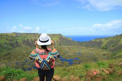 Female Appreciating the Breathtaking View of Rano Kau Crater Lake from Orongo Ceremonial Village on Easter Island, Chile stock photo