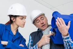Female apprentice construction worker royalty free stock image