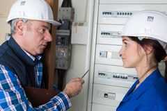 Female apprentice electrical engineer. Fuse royalty free stock photography