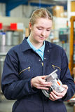 Female Apprentice Engineer Checking Component Royalty Free Stock Images