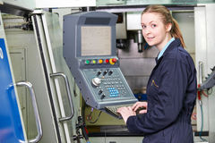 Female Apprentice Engineer Operating Computerized Cutting Machin Stock Image
