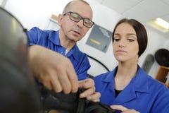 Female apprentice engineer working. Female royalty free stock image