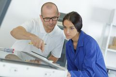Female apprentice with teacher. Female royalty free stock photography