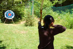 Female archer. Aiming at target Royalty Free Stock Image