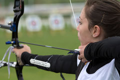 Female archer aiming with her bow. AUCH, FRANCE - MAY 11:  an unidentified female competitor is aiming to shoot with a bow and an arrow, at the National Stock Images