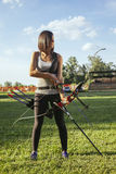 Female Archer. Front View Of Female Archer Training At The Range Stock Photos
