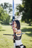 Female Archer. Front View Of Female Archer Training At The Range Royalty Free Stock Photo