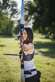 Female Archer. Front View Of Female Archer Training At The Range Royalty Free Stock Image