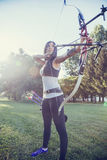 Female Archer. Front View Of Female Archer Training At The Range Stock Images