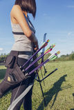 Female Archer. Front View Of Female Archer Training At The Range Stock Photography