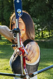 Female Archer. Front View Of Female Archer Training At The Range. Focus Is On Bow And Arrow Royalty Free Stock Photo