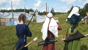 Female Archer`s shoots with an arrow. Russian arhecrs stock footage