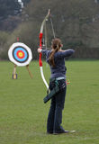 Female Archer Sport Target. Female archer aiming at target Stock Photos