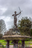 Female archer statue. Statue of a naked female archer in rose garden hyde park London Stock Photography