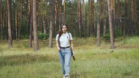 Female archer walking in the forest