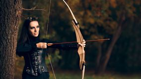 Female Archer Warrior in Costume with Bow and Arrow Stock Image