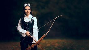 Female Archer Warrior in Costume with Bow and Arrow. Steampunk warrior princess hunting in nature Stock Photo