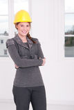 Female architect. Young architect is standing in a white room Royalty Free Stock Photography