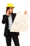 Female Architect. On the phone holding a plan royalty free stock images