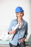 Female architect. With building plans Royalty Free Stock Photo