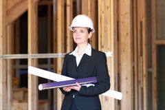 Female Architect. Young female architect at construction site Stock Image