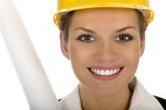 Female architect. Holding blueprints, smiling Royalty Free Stock Images