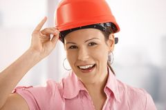 Female architect adjusting her hardhat Stock Photography