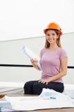Female Architect With Blueprint Stock Photography