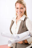 Female architect blueprints smiling hold Stock Photography