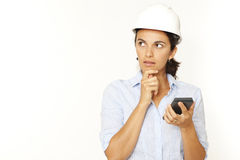 Female architect calculating looking to a side. Female architect calculating on white background and looking to side Stock Photos